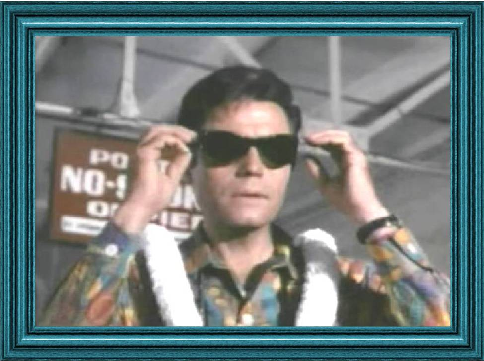 Jack Lord wearing a very loud aloha shirt. From the first episode Full Fathom Five