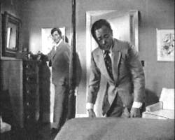 Kam Fong and Jack Lord search a room